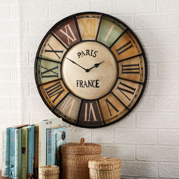 Vintage Metal Wall Clock | Multi coloured metal wall clock with roman numerals.